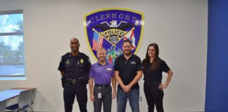 From left, Clermont Police Chief Charles Broadway, City of Clermont IT Director Don Dennis and Seth Bartee and Amy Pontillo, both of TraCS, worked together to restore TraCS' servers.