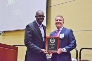 Clermont City Manager Darren Gray, right, receives the 2019 UCF Alumni Achievement Award in Public Administration, presented to him on May 7 by Associate Professor Abdul-Akeem Sadiq.